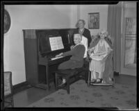 Josephine O'Leary, Mrs. Emma Cauley, and Mrs. Bessie Barrie around piano, 1935
