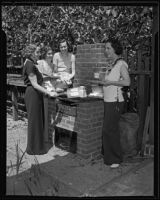 Mrs. Guenther, Miss. Schweitzer, Mrs. Stewart, and Mrs. Reinard grill breakfast in the garden, Los Angeles, 1935