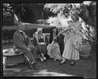 Bishop W. Bertrand Stevens, Mrs. Stevens, and Mrs. Moore admire Shirley Wells in the gardens, Bel-Air, 1935