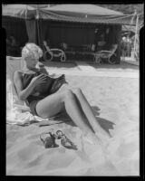 Janet Chandler reads a book on the beach, Pacific Palisades, 1935