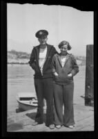 Mr. and Mrs. G. L. Stevens stand on a boat dock, California