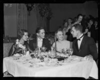 Roberta Von Kleinsmid, Jack Rendlar, Marguerite Blake, and Jack Erdley attend a party at the Bel Air Bay Club, Pacific Palisades (Los Angeles), 1933-1935