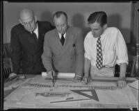 Gilbert Underwood, Carroll Pratt and Stephen Stack examine a map, Los Angeles, 1935