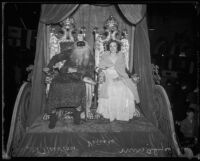 Al Newton, dressed as King Neptune, and Alyce Young at a Mardi Gras parade, Venice (Calif.), 1935