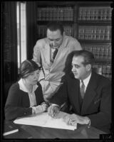 Emma Gloeckner, C. Lloyd Fisher, and Vincent A. Marco discuss Bruno Hauptmann's case, Hollywood, 1935