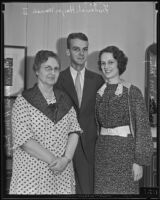 Gertrude McIntyre, wife of President Roosevelt's Secretary, with her daughter Marie McIntyre and her fiance Frederick Hayes Warren II, Los Angeles, 1935