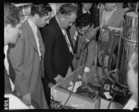 Dr. C.C. Warn observing Dr. Ralph Willard's frozen monkey experiment, Los Angeles, 1935