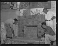 Men laying tiles on a fireplace, Los Angeles, 1935