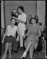 Pauline Spinner teaching Marion Harley and Ethel Churchill about styling hair, Los Angeles, 1935