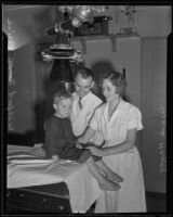 E. L. Scott and Grace Havey taking X-rays of Wilford Price, Los Angeles, 1935