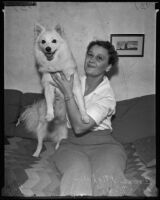Kidnapped dog Kimo and his rightful owner Irene Mighell, Los Angeles, 1935