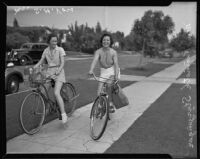 Arletta Sturzenger and Mrs. S. H. Voss riding to market on their bicycles, Los Angeles, 1935