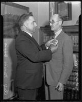 Chief James Davis pins a badge to William Adolph, Los Angeles, 1935