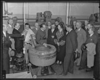 Asst. Jailer C. A. Fitzgerald leads 1935 Grand Jury on tour of laundry room at County Jail, Los Angeles, 1935