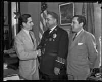 Chief James E. Davis greets Mexican Consul Ricardo G. Hill and his brother Benjamin Hill, Jr., Los Angeles, 1935