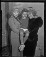 Actresses and sisters Rosetta Duncan and Vivian Duncan hold Vivian's daughter, Evelyn, Los Angeles, 1935