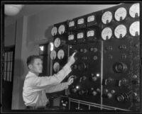 Carl W. Koiner adjusts the time, Pasadena, 1935