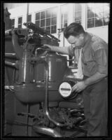 Engineer Walter H. Schahfer with a power generator, Pasadena, 1935