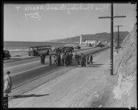 Judge and jury examine an automobile crash site on the Pacific Coast Highway, Los Angeles, 1935