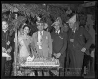 Gene Biscailuz, Ricardo Hill, Trini Varala, Harry Chandler and others gather around the celebratory cake, Olvera Street, Los Angeles, 1935