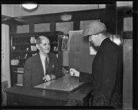 Jack Royal reenacting an attempted robbery at his hotel with Juo Tucker, Los Angeles, 1935