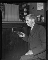 Jack Royal reenacting an attempted robbery at his hotel, Los Angeles, 1935