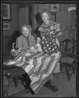 Ann Anderson and Mrs. L. J. Nelsen repair the American flag, Los Angeles, 1935