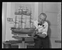 Hugh Wilson repairs a model ship, Los Angeles, 1935