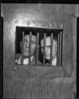 Dan McNally and Jonathan Perkins Posing Behind Bars, Los Angeles, 1935