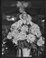 Ethel Ziegler posing with flowers at the Los Angeles County Fair, Pomona, 1935