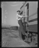 J.A. Burke, assistant chief engineer rides on the new Santa Fe Diesel train during a test run from Chicago to Los Angeles, Los Angeles, 1935