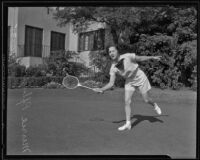 Merrie Pfluger plays badminton in the athletic department of the California Women of the Golden West, Los Angeles, 1935