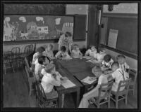 Students in the classroom on the first day back to school, Montebello, 1935
