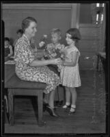 Mrs. Dorothy Bothman, Kenneth Knollenberg, and Christine Ullrich on the first day back to school, Montebello, 1935