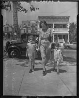 Mrs. W.E. Nickerson walking with daughters Joan and Mary, 1935