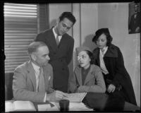 Ruth Lee, Hazel Lee Burgess, and Jack Passin consulting with attorney George Johnson regarding Ruth Lee's injury, 1935