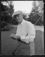 George W. Dickinson holding golf club at the Los Angeles Country Club, Los Angeles, 1935