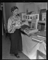 Frances Steloff, bookseller, with her collection at the Biltmore Hotel, Los Angeles, 1935