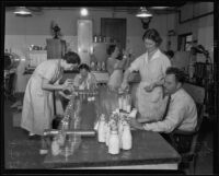 Dr. R. V. Stone, Ellen Kimberly, Carolyn Lacy, Katherine Sing, and Euring Drake analyze milk and cream, Los Angeles, 1935
