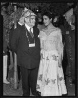 Isidore B. Dockweiler and Adriana Figueroa celebrating the city's one hundred and fifty-fourth anniversary at Olvera Street, Los Angeles, 1935