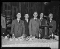 Rupert Hughes, Dr. F. Fern Petty, Dr. J. Whitcomb Brougher, Sr., Frank Weller, and Dr. Robert Millikan discuss Community Chest funds, Los Angeles, 1935
