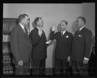Judge Edward T. Bishop and Joe Crider, Jr. watch as Frank S. Hutton swears in Goodwin Knight, Los Angeles, 1935