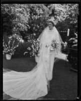 Charlotte Holden Hall Ford shows off her wedding gown, Montecito, 1935