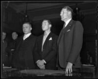 Attorneys J. G. Porter and Ellery Cuff stand with Leroy Drake as he receives a life sentence, Los Angeles, 1935