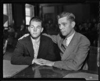 Leroy Drake, Sr. puts an arm around his son Leroy Drake, Jr. in court, Long Beach, 1935