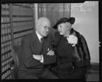Clyda E. Willis whispering to her husband, Judge Henry M. Willis, Los Angeles, 1935
