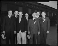 Fred McCargar and others on the Reception Committee standing outside President Roosevelt's train, Los Angeles, 1935