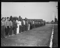 Young men at the C. C. C. camp in Griffith Park waiting to greet President Roosevelt, Los Angeles, 1935