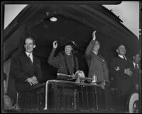President Roosevelt and Mrs. Roosevelt waving good-bye from the train at Central Station, Los Angeles, 1935