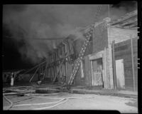 Firefighters battle flames at W. E. Bockmon Pottery and Tile Company, Los Angeles, 1935